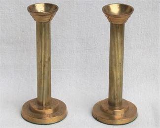 """$24 - Pair brass candlesticks w/ felt bottoms.  H: 7""""   base diameter: 3"""" [Bin 15]"""