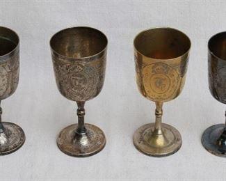 "$60 - Set of 7 incised stemmed metal goblets, gold/silver, ""T"" monogram.  Each H: 6.5""   cup diameter: 3"" [Bin 15]"