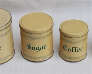 """$30 - Vintage labeled canister set of 4 canisters, cream & green.  H: 7.5""""   diameter of largest: 7"""" [Bin 12C]"""