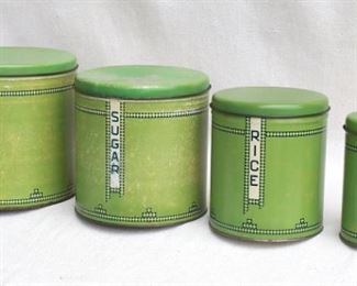 """$30 - Vintage labeled canister set of 4 canisters, green Deco decoration.  H: 8""""   diameter of largest: 8.5"""" [Bin 12C]"""