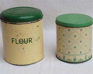 "$20 - Left: vintage flour canister, cream & green.  H: 8.5""   diameter: 7.5"" Right: Vintage unlabeled canister, windmill decoration.  H: 6.5""   diameter: 6"" [Bin 12C]"
