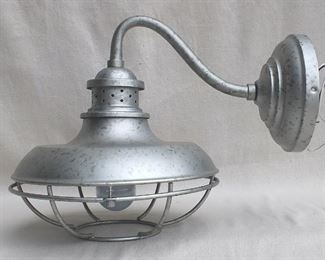 """$40 - Wall-mounted metal light fixture, distressed aluminum finish, cage for bulb, new & never used.  W: 12""""   H: 13""""   D: 17""""   diameter of base: 7"""" [Bin 11C]"""