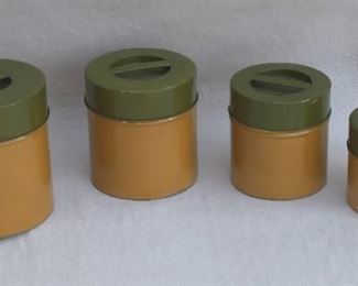 $35 -1970s set of 4 metal canisters, ochre and olive.  [Bin 10B]