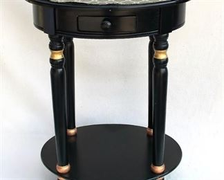 "$120 - Wood table, dark stain w/ gold trim, 4 legs w/ lower shelf, oval top w/ glued on mat, 1 drawer w/ pull.  W: 19.5""   H: 27.5""   D: 15.5"""