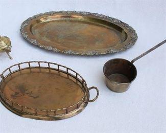 "$40 - LOT- Cast brass platter, edged w/ grapevines in bas relief.  L: 20""   W: 13.5""   H: 1""  - Brass gallery tray, 2 handles.  L: 15""   W: 8.5""   H: 2""     $40 - LOT - Brass dipper w/ 9"" handle.  H: 2.5""   cup diameter: 4.5""    - Covered brass pot, 3 cast ram's heads/feet applied.  W: 3.5""   H: 4.5"" [Bin 7C]"