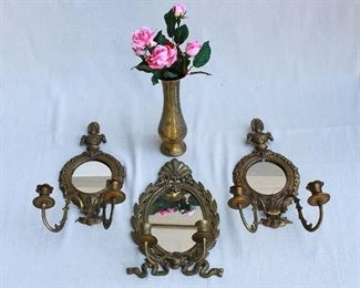 """$50 - LOT- Incised brass vase containing artificial pink roses.  H: 9.5""""  Center: Mirrored wall sconce for 2 candles.  W: 8""""   H: 13.5""""  Right and left: pair of mirrored wall sconces, each for two candles.  W: 8.5""""   H: 16.5"""" [Bin 7A]"""