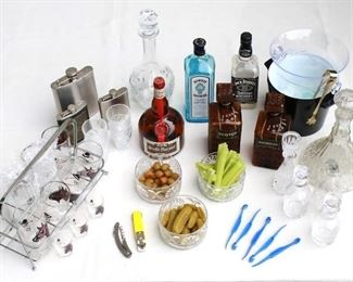 $75 - LOT of bar supplies: liquor bottles, decanters, flasks; ice buckets w/ ice; openers, citrus peelers; glass dishes of olives, pickles, celery  [Bin 5a]