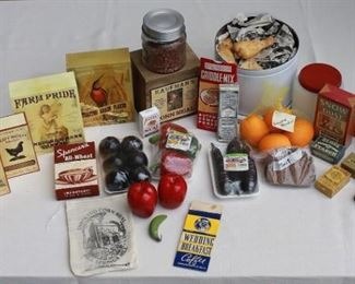 $60 - LOT of vintage fake food & kitchen supplies: items for washing (soap, starch) (7); boxes of cereal (5); boxes of meal/flour (5); bag of coffee (1); box of maple flavoring (1); pkgs of shrink-wrapped vegetables (3); red apples (2); small green banana (1); net bag of 4 oranges (1); slices of pumpernickel bread (2); jar of dried beans (1); milk glass jar w/ red metal top (1); large white tin of fried chicken (1).  [Bin 6