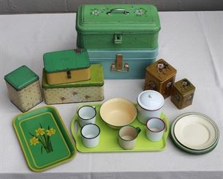 $50 - Enamelware containers, most cream & green: enameled tray w/ daffodils ($x); patterned cannister ($x); patterned biscuit tin ($x); latched Lunch Box ($x); bread box w/ painted flowers ($x); large latched tin w/ handles ($x); set of 4 enameled dinner plates ($x); set of 3 enameled salad plates ($x); set of 6 nesting tea caddies, Asian pattern ($x); set of 3 handled mugs ($x); handleless mug ($x); green plastic tray ($x)  [Bin 2]