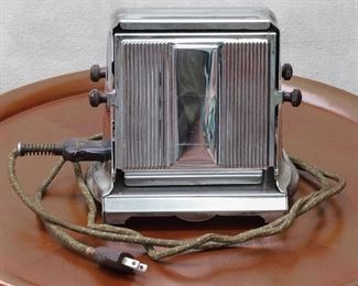 """$30 - Early electric toaster w/ original cord, manual, 2-slice, silver & black, Manning-Bowman & Co., Meriden CT.  W: 7.5""""   H: 7.5""""   D: 5.5""""   cord length: 72"""" [Props]"""