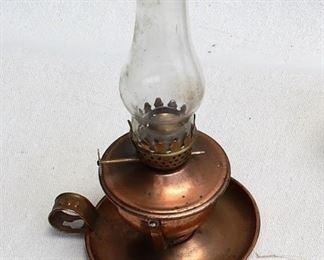 "$20 - Kerosene lamp, copper base w/ handle, glass chimney.  H: 8""   Diam: 4"" - 2 available [Props]"