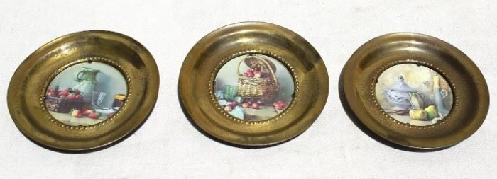 """$25 - Set of 3 picture plates: Still life scenes in round brass frames, self-hangers.  W: 6""""   D: 0.5"""" [Props]"""