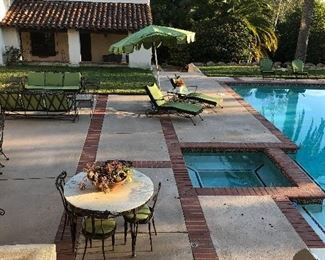 1950s vintage wrought iron patio furniture in an original Lillian Rice home in Rancho Santa Fe.