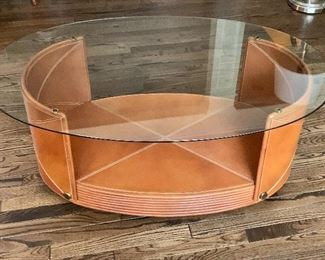 "$495 - Oval Glass Topped Coffee Table with leather stitched base, 18.5"" H x 29.5"" D x 46"" W"