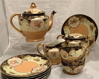 "$125 - Handpainted Japanese 13-Pc Tea Set: teapot, creamer, sugar bowl, four teacups and six dessert plates. Teapot is 7.5"" H; sugar bowl is 6"" H, creamer is 4"" H ; dessert plates are 7.25""; cups are 2.25"" H"