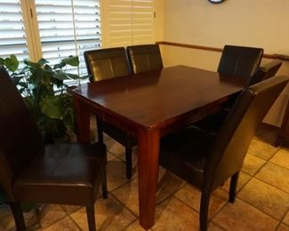 dining table and chairs, large plant