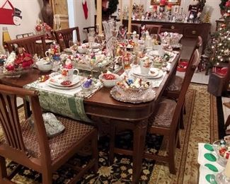 VINTAGE MAHOGANY DINING TABLE with 3 LEAVES & 8 CHAIRS filled with Christmas Ornaments