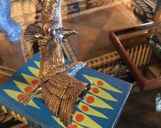 Brass soaring eagles