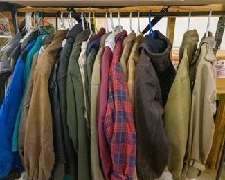 Lots of men's coats and jackets