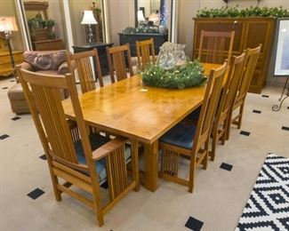 This beautiful set was purchased for approximately $15,000.  The chairs are 'Stickly', and the table was custom made in Mexico.