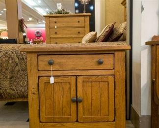 Nightstand that is part of a beautiful king bedroom suite!