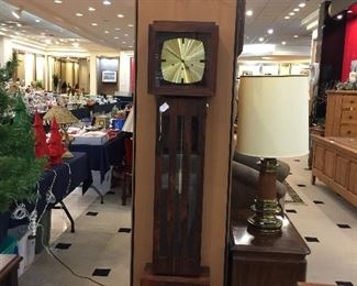 Colonial Co. mid century modern Grandmother clock made of rosewood really nice looking.