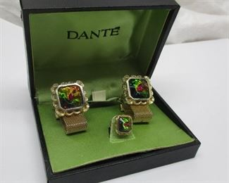 A vintage Dante Volcano men's mesh wrap cuff link set with tie pin and original box.  Glass appears to change colors when moved - giving a dichroic or watermelon effect.  One discoloration spot on the mesh