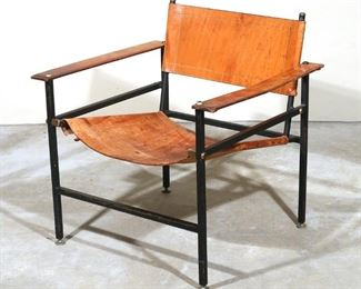 Lot 54   LEATHER SUSPENSION ARMCHAIR