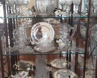 Covered cut glass punch bowl...American Brillant cut glass, Silverplate tea set....