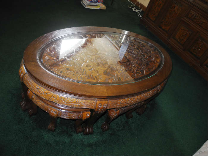 Hand carved Asian coffee table with stools underneath