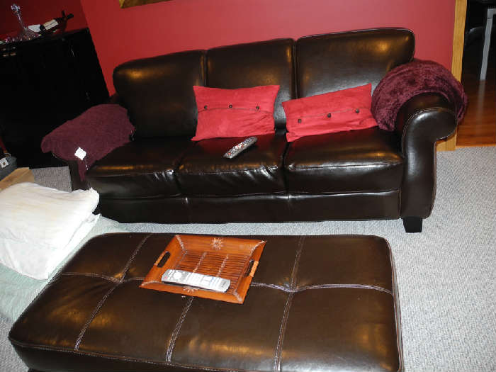 Gorgeous leather sofa and ottoman (can be purchased separately)