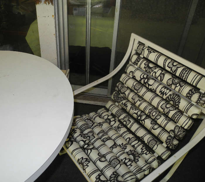 Very cool black and white patio set, currently in screened in porch