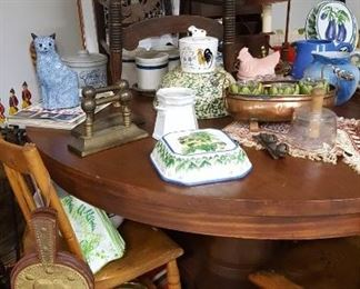 Antique mahogany round table and stoneware