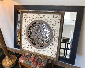 Picture Decor in front of large black frame mirror