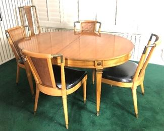 Lot #6,  Picture 2. Price $1499. Beautiful Mid Century Dining Set including Table + 2 Leaves, 6 Chairs, and Leather Pad.  This set is in Very Good Condition for its age. Very few marks on this set and black vinyl chair seats have no rips. . It has been lovingly cared for. Excellent Quality! This picture is without the leaves. Not subject to 25% Discount