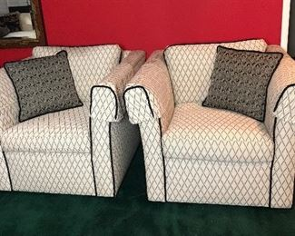 """Lot #1. Price $580 - Pair of Custom Upholstered Black & White Chairs + Pillows. Dimensions: 37.5""""W x 38""""D x 28.75""""T. Excellent Condition.  Not subject to 25% Discount."""