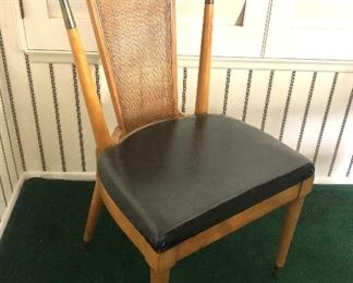 Lot #6,  Picture 3. Price $1499. Beautiful Mid Century Dining Set including Table + 2 Leaves, 6 Chairs, and Leather Pad. This is a picture of the shorter side chair with nice vinyl seat. Not subject to 25% discount