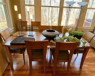 Dinec dining table with 8 chairs and 2 leaves.