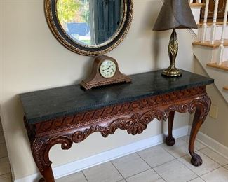 """Entry Hall Accent Table with Marble Top : $175.  Center Hall Round Mirror (30""""):  $60  Wuersch (Fall River, MA) Mantle Clock:  $50"""