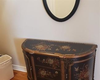 Oriental cabinet measures 48 w x 33 T x 18 d.  Presale $95.   matching black oval mirror presale is $35