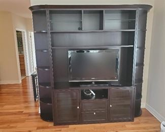 Large dark brown wall unit.  Measures 88 x 92.  Glass shelves.  Comes apart in 6 pieces.  Presale $145