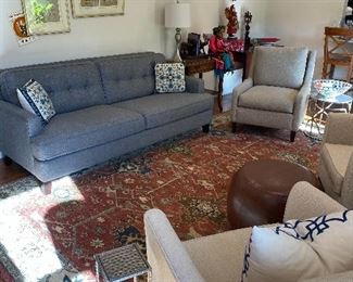 Living room view showing furniture, large quality rug, and more