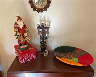 $125.00 19th Century drop leaf table, $30.00 Santa, $58.00 Folk carved cross, $48.00 Decorative charger