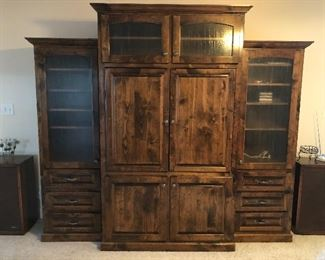Beautiful custom made, solid wood entertainment center. In 3 parts, total with 8ft, 2 inch, 7ft 2inch tall. $1200 Available for pre-sale, please call for appointment 865-617-0420