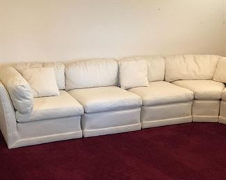 Sectional in excellent condition, upholstery in white. 10ft by 8ft. $600 Available for pre-sale, please call for appointment 865-617-0420