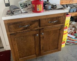 Double door cabinet with white mica top