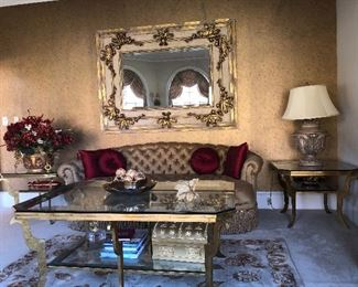 Tufted silk gold sofa and gilded coffee table and end tables