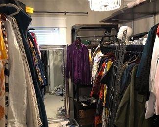3 closest of designer clothes. One closet full of Saint John