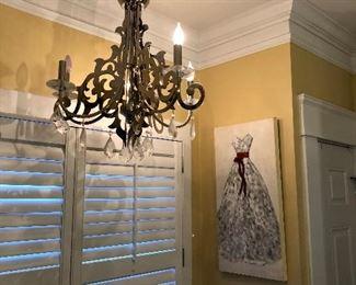 chrome chandelier in master bathroom