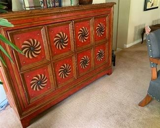 Decorator cabinet with painted pinwheel accents